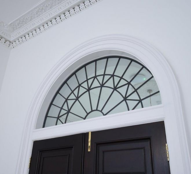 Commercial office renovation transom window fully restored