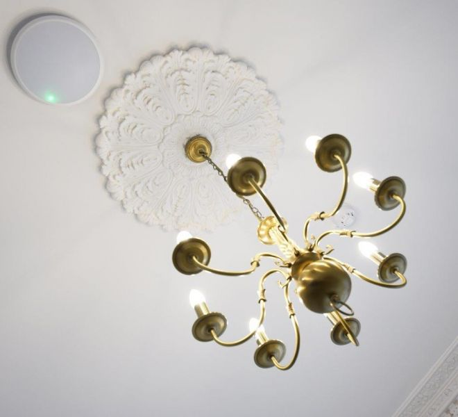 Refurbished brass chandelier with fully restored ceiling rose in london by Brompton cross Construction