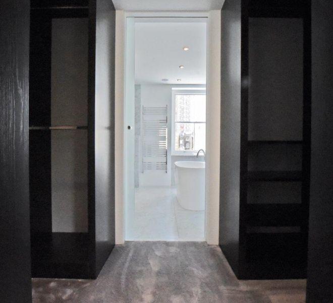 Walk in wardrobe design and ensuite bathroom in Knightsbridge