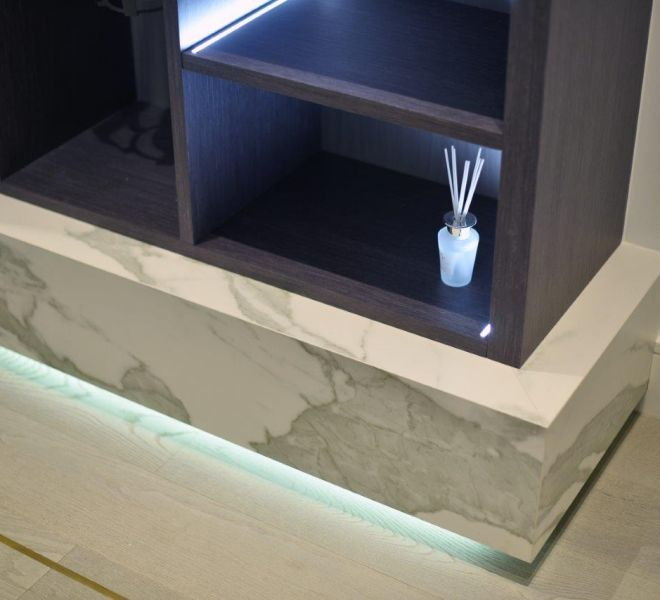 Bespoke marble and hardwood media unit with LED lighting by Brompton Cross