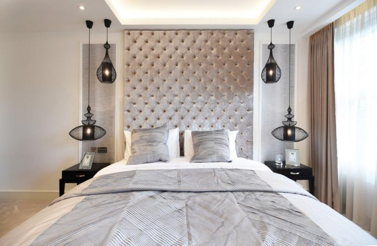 Stunning high end bedroom design by Brompton Cross Construction with large head board