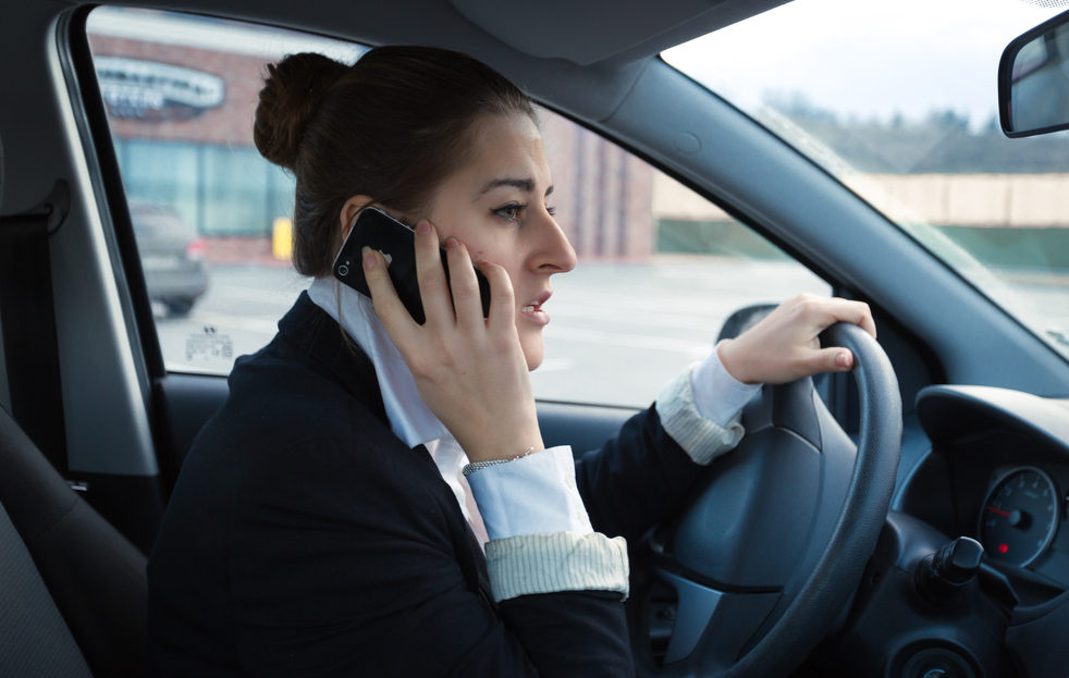 Can I use my cellphone while driving if it's an emergency?