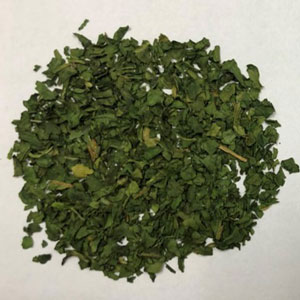 Dehydrated spinach flake before undergoing IRD treatment