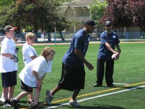 Geroy Simon puts a young receiver through his paces.