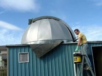John Purdy working on roof