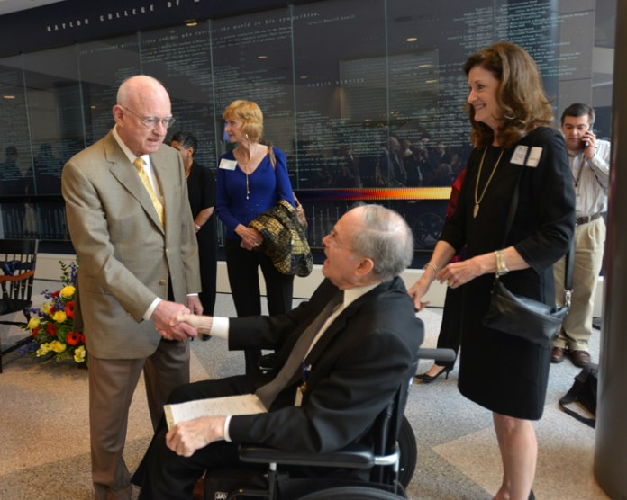 Dr. Bill Butler greets Dr. Holcomb