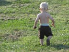 Strolling through the hay field with a wooden spoon.