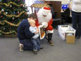 My son and I seeing Santa at the library