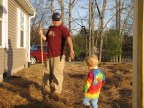 Father and son working in the yard on a pretty spring day