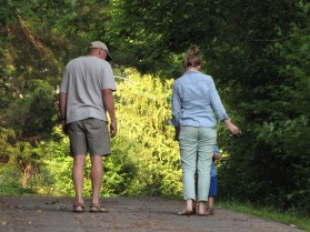 My dad, sis, and son taking a walk after the shower
