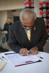Horace Mitchell signing The Kern Promise