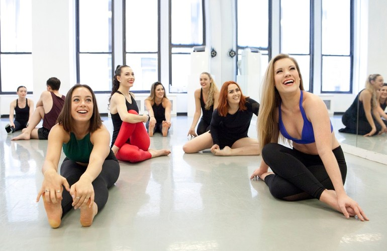 Dancers stretching at Broadway Dance Center