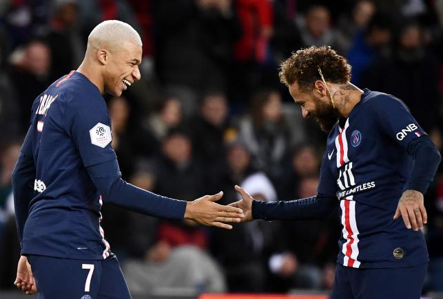 Paris Saint-Germain's French forward Kylian Mbappe (L) is congratuled by Paris Saint-Germain's Brazilian forward Neymar after scoring a goal during the French L1 football match between Paris Saint-Germain (PSG) and Amiens at the Parc des Princes stadium in Paris on Saturday. Photo: AFP