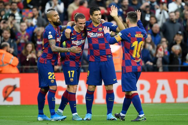 Barcelona`s French forward Antoine Griezmann (3R) celebrates with Barcelona`s Chilean midfielder Arturo Vidal, Barcelona`s Uruguayan forward Luis Suarez and Barcelona`s Argentine forward Lionel Messi after scoring a goal during the Spanish league football match FC Barcelona against Deportivo Alaves at the Camp Nou stadium in Barcelona on 21 December 2019. Photo: AFP