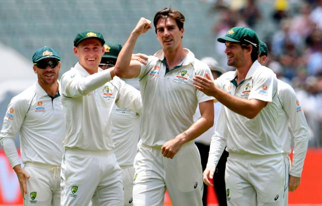 Australian paceman Pat Cummins (C) gestures to New Zealand fans after dismissing New Zealand batsman Tom Latham on the third day of the second cricket Test match at the MCG in Melbourne on 28 December 2019. Photo: AFP