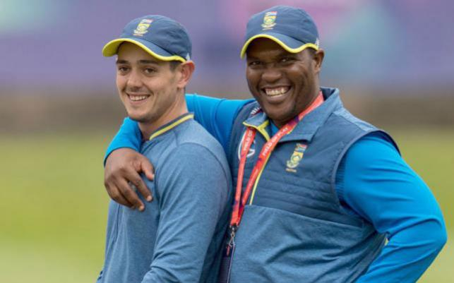 South Africa's wicketkeeper Quinton de Kock (L) is embraced by CSA selection convenor Linda Zondi at a training session at Edgbaston in Birmingham, central England on 18 June 2019, ahead of their 2019 World Cup match against New Zealand. Photo: AFP