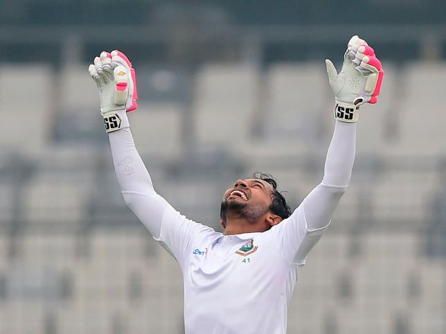 Bangladesh`s Mushfiqur Rahim reacts after scoring a double century (200 runs) during the third day of a Test cricket match between Bangladesh and Zimbabwe at the Sher-e-Bangla National Cricket Stadium in Dhaka on 24 February, 2020. Photo: AFP