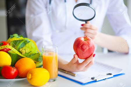 Diet. Doctor Nutritionist hold red apple in her office. Concept of natural food and healthy lifestyle. Fitness and healthy food diet concept. Balanced diet with vegetables.