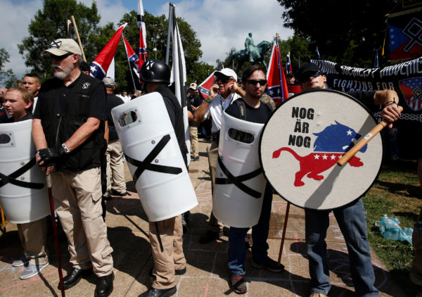 White supremacists stand behind their shields at a rally in Charlottesville, Virginia, Aug. 12, 2017.
