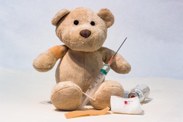 teddy bear with syringe