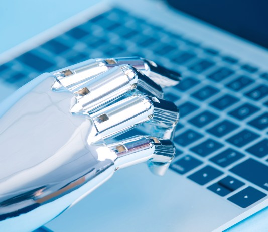 robot hand using laptop