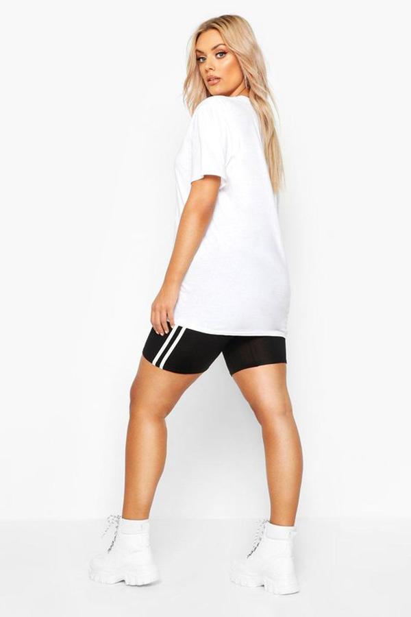 A plus-size model wearing black bike shorts.