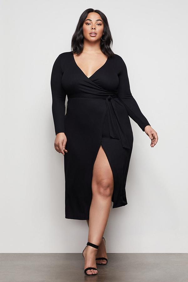 Woman wearing a black cocktail dress.