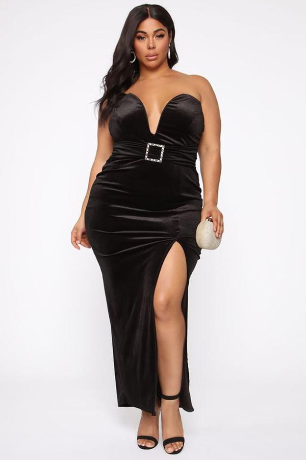 Woman wearing a black velvet cocktail dress.