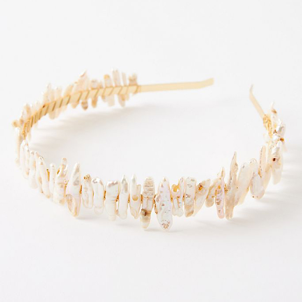 A headband crafted from puka shell pieces.