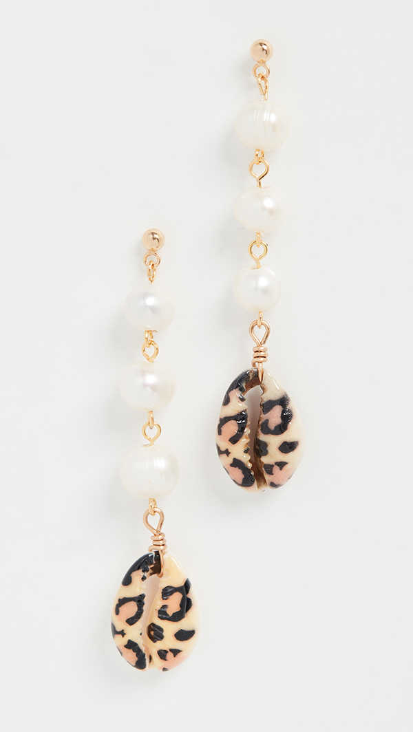 A pair of drop earrings crafted from pearls and painted cowrie shells.