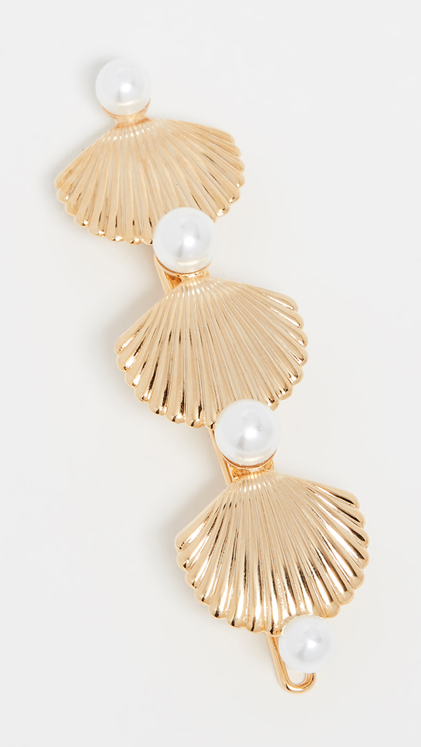 A hair barrette lined with gold-plated scallop shells.