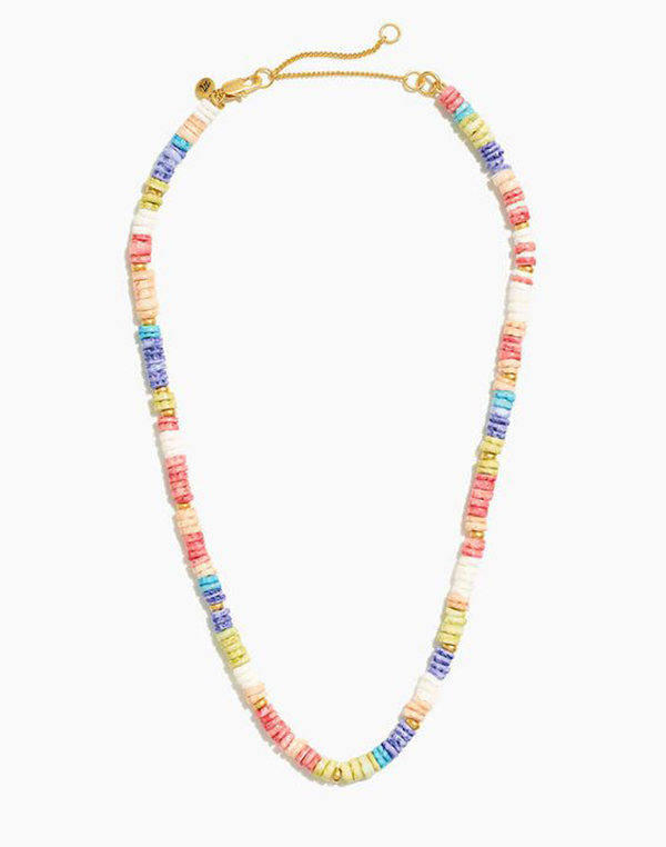 A rainbow necklace crafted from rounded puka shells.