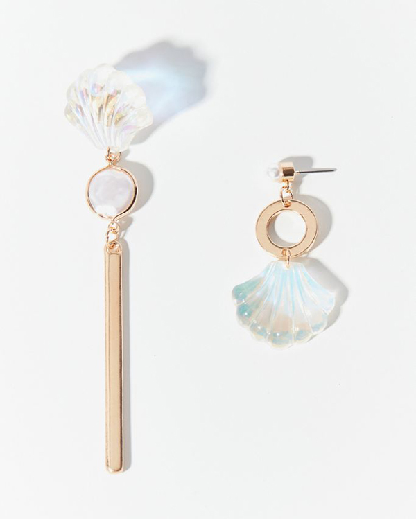 A pair of asymmetrical earrings with iridescent plastic scallop shells on them.
