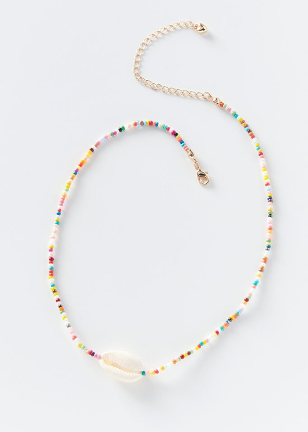 A beaded necklace with a cowrie shell on it.