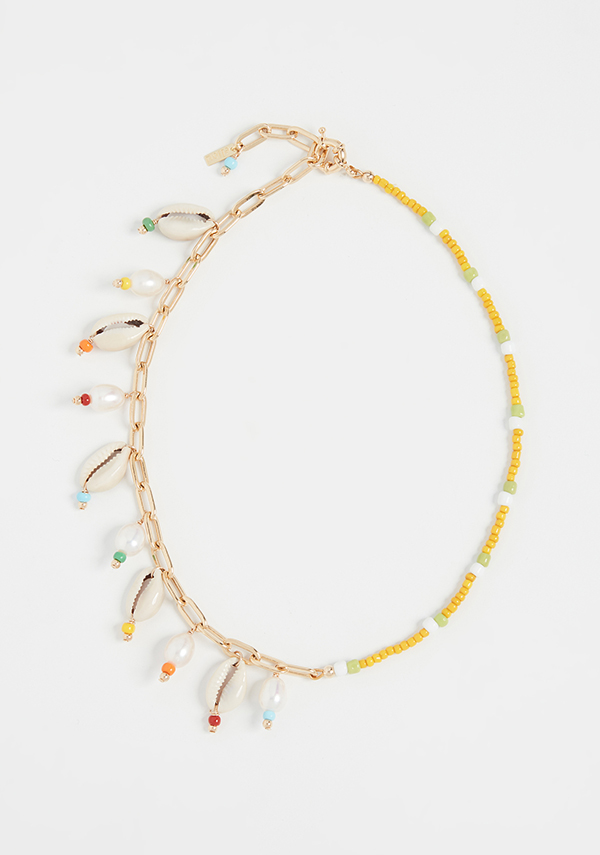 A beaded necklace, lined on one side with cowrie shells.