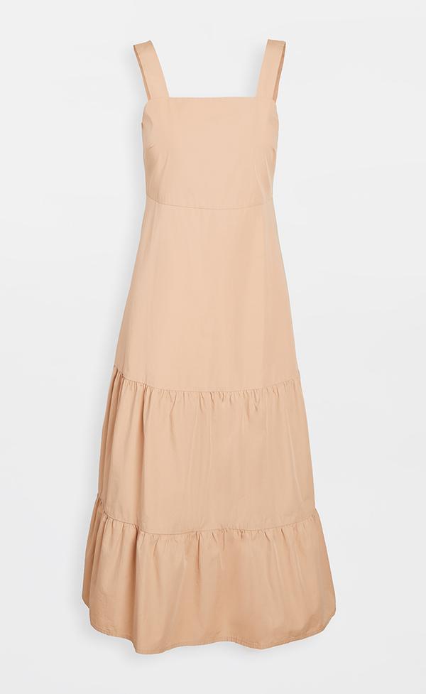 A plus-size tan midi dress.