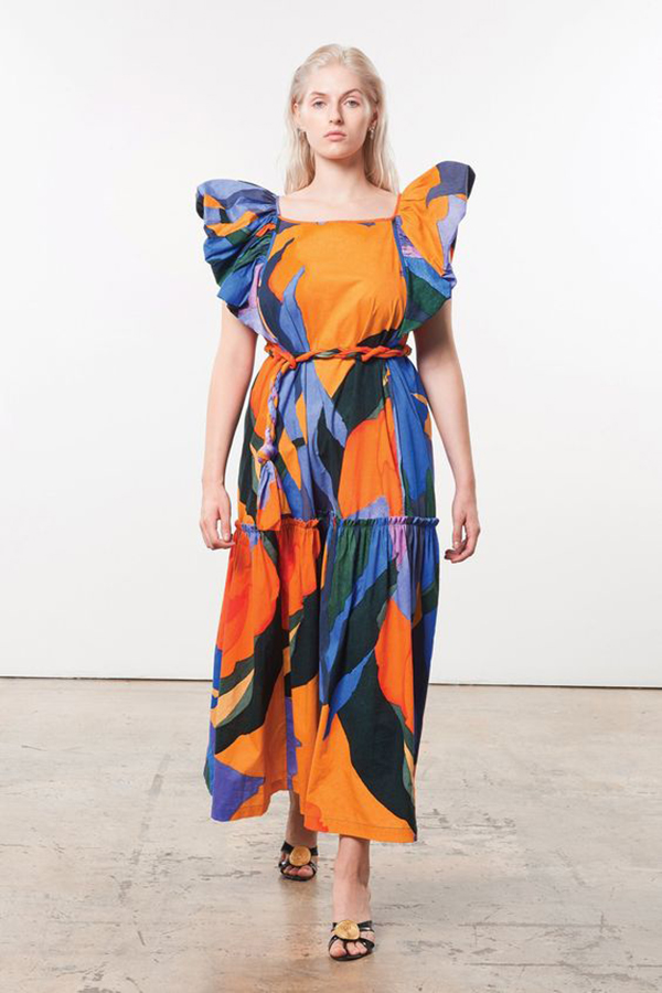 A plus-size model wearing a printed dress.