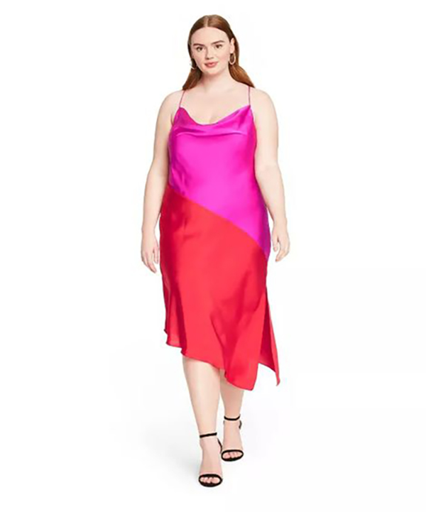A plus-size model wearing a hot pink and red slip dress.