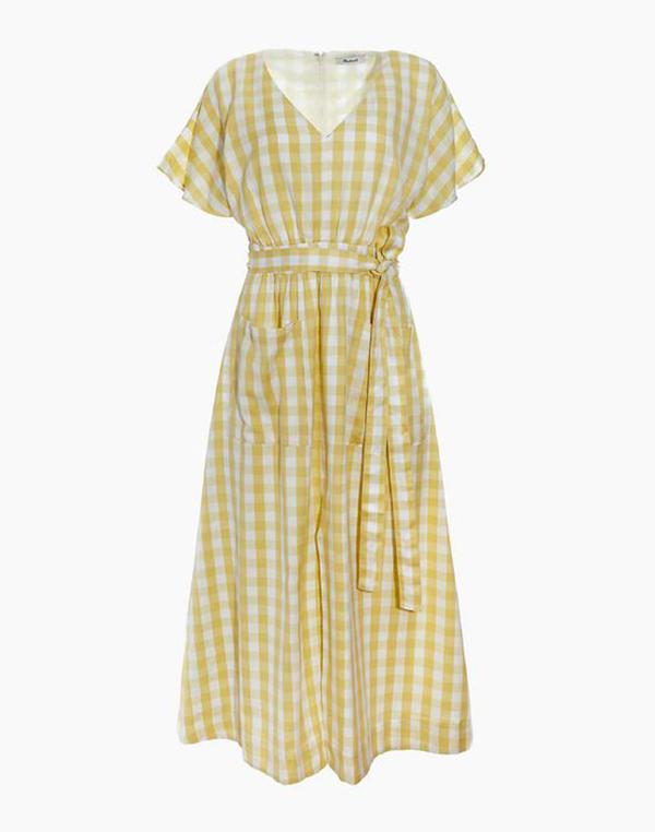 A plus-size yellow gingham midi dress.