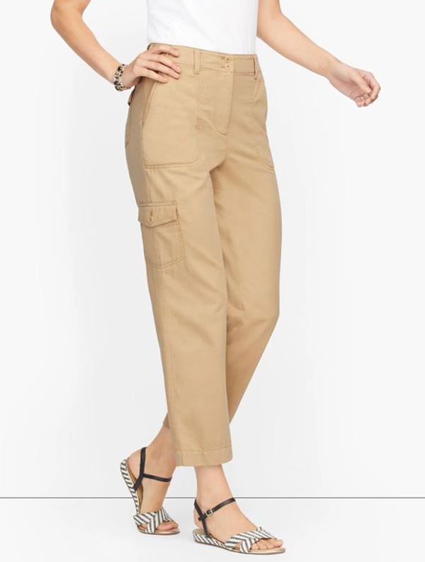 A model wearing beige cargo pants.