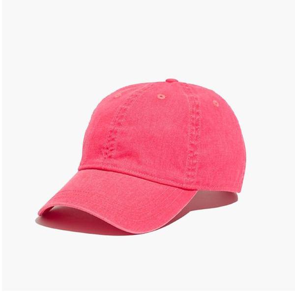 A neon pink baseball cap.