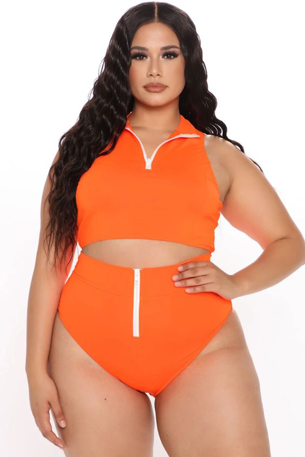 A plus-size model wearing a neon orange bikini.