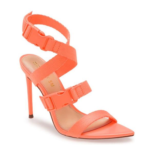 A neon orange strappy stiletto.