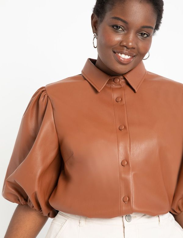 A model wearing a plus-size puff-sleeve top.