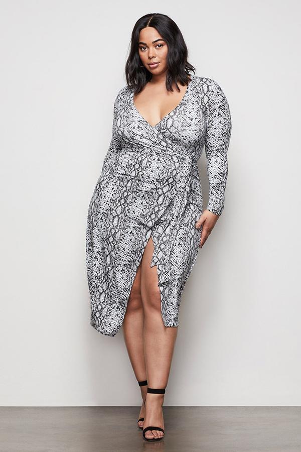 A plus-size model wearing a snakeskin dress.