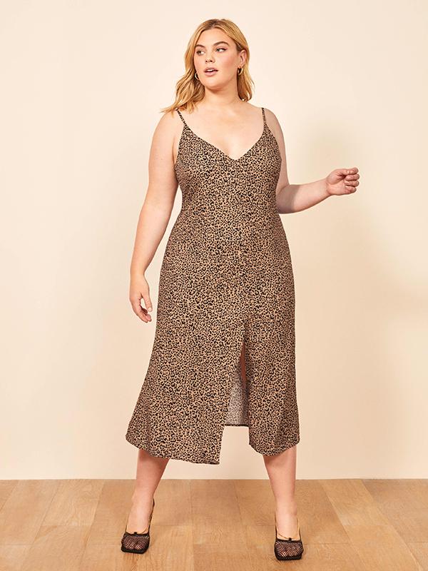A plus-size model wearing an animal print slip dress.