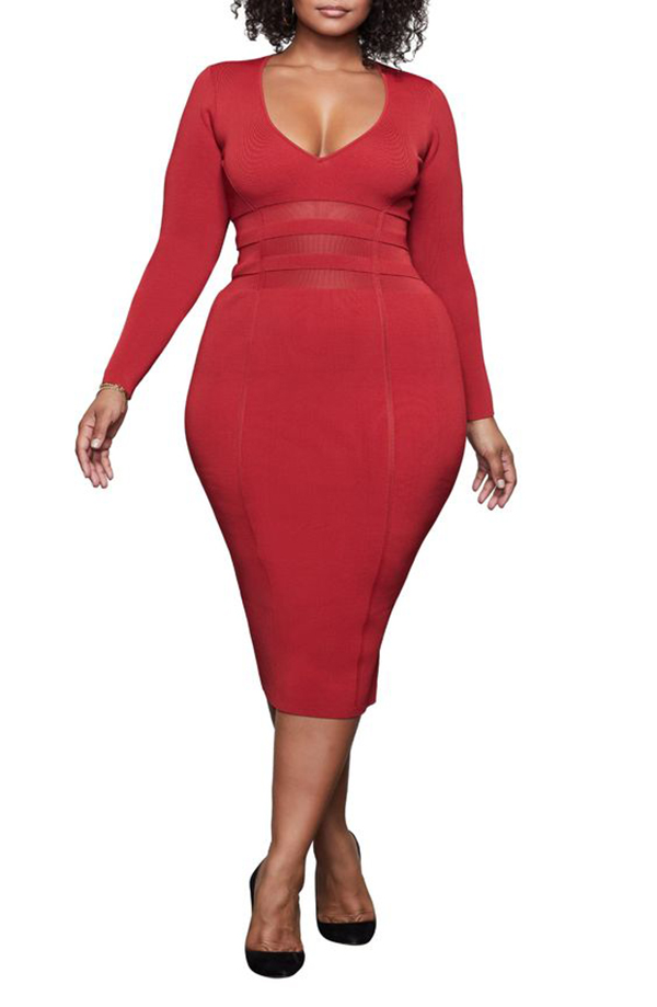 A plus-size model wearing a red midi dress.