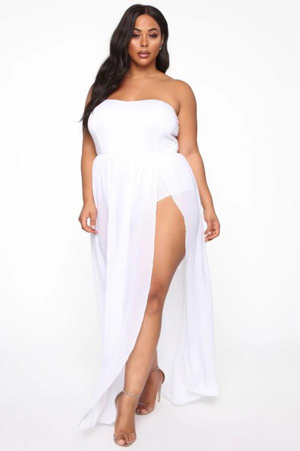 A plus-size model wearing a white strapless dress.