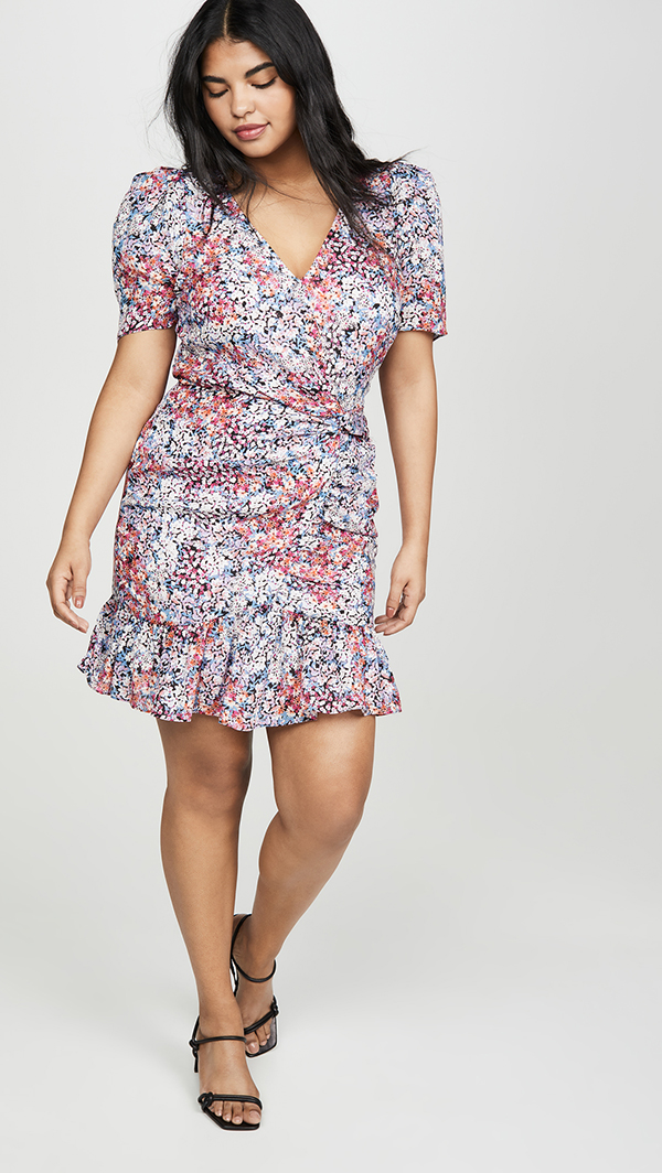 A plus-size model wearing a floral dress.