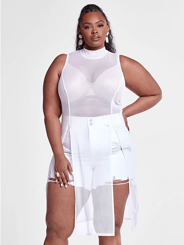 A model wearing a plus-size sheer top.